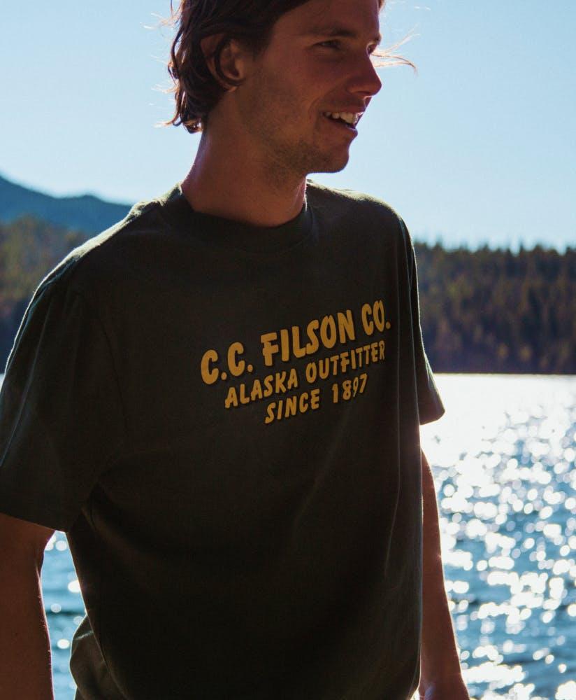 Man wearing filson t-shirt