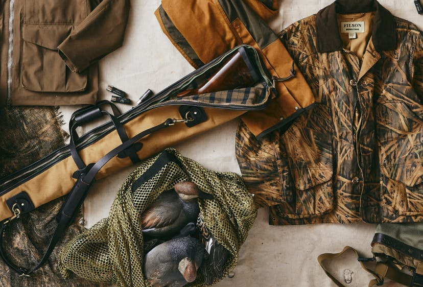 A spread of Filson hunting gear and apparel