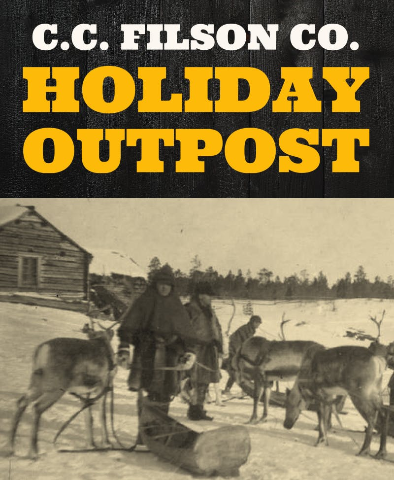 Men with caribou/elk and sleds, standing outside in the snow